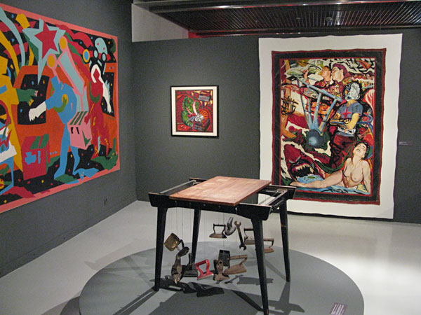 "A replica of Ivan Sotnikov's and Timur Novikov's Utiugon at the exhibtion 'Notes from the Underground', Muzeum Sztuki, Łódź, Poland, 2016.  Paintings by (E-E) Evgenij Kozlov: ""Love for Work"" (1990), ""Portrait of Oleg Kotelnikov with Moustache, Crocodile and Dot"" (1988), Shark (1988) Photo: Hannelore Fobo, 2016"